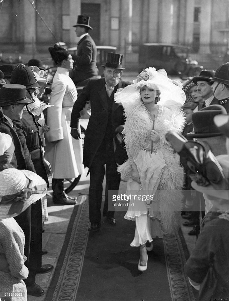 Marlene Dietrich as Alexandra with Herbert Lomas, as General Gregor Vladinoff, in the film 'Knight without Armour'.