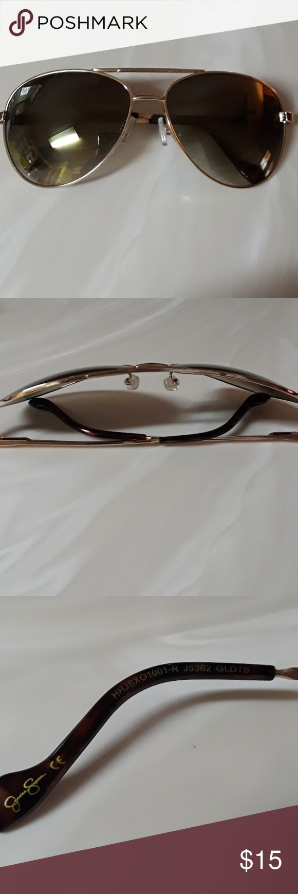Jessica Simpson Gold Aviator Sunglasses In great conditon, there are very minor scratches on the lens which is hard to notice  when wearing. No glasses case.  J5362 Glots Jessica Simpson Accessories Sunglasses
