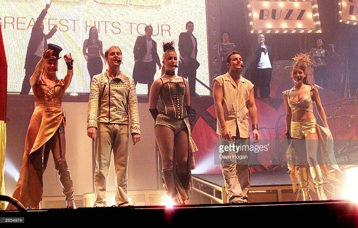 British pop stars Faye Tozer, Ian 'H' Watkins, Lee Latchford-Evans, Claire Richards and Lisa Scott Lee of the pop group 'Steps' performs on stage at Wembley Arena as part of their 'Gold - Greatest Hits' tour on December 22, 2001 in London.