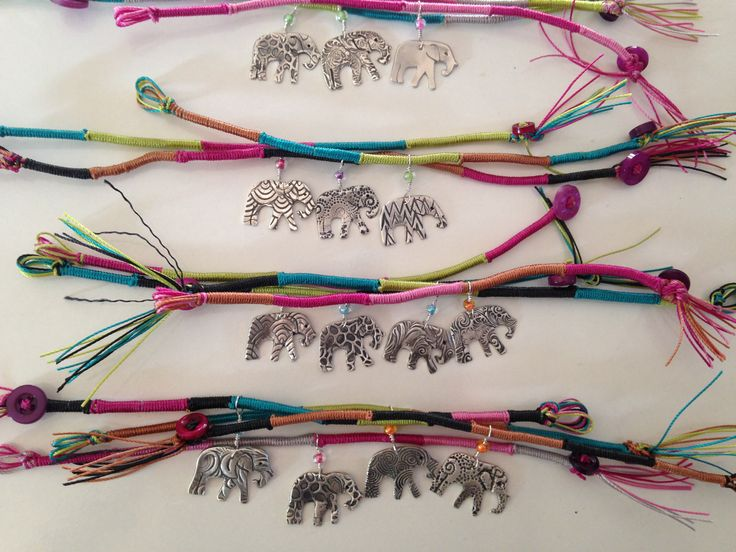 Finished bracelets donated to the Enormous Elephant art Exhibition. Elephant charms made from silver metal clay and bracelets made from silk.