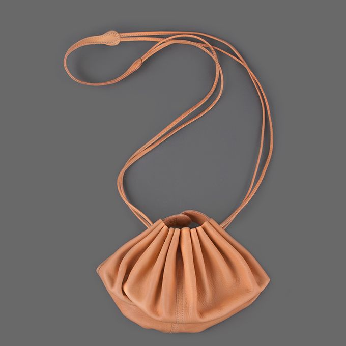 < Il Bisonte Drawstring Pouch in Natural $422.00  Made in Italy.  -This unique bag is made with premium leather. This leather will darken with time, handling and exposure to sunlight. -Drawstring closure.