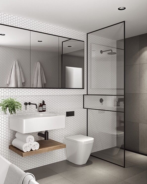 I like the low profile sink and toilet and the paneled shower partition. Not so keen on the tile