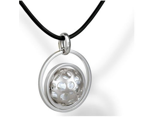 Crafted from sterling silver, the Himalayan CrystalWorld Pendant taps into the harmonising power of raw,untouched Himalayan Crystals, helping to create a balanced energy force for the wearer. With its endearing,whimsical design, the pendant features a delicate ball that rotates along a diagonal axis, encompassed within two silver spheres