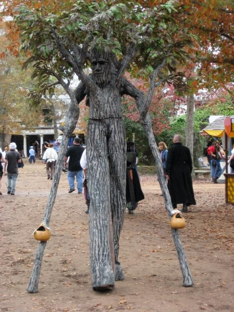 Message adult tree costume with stilts agree