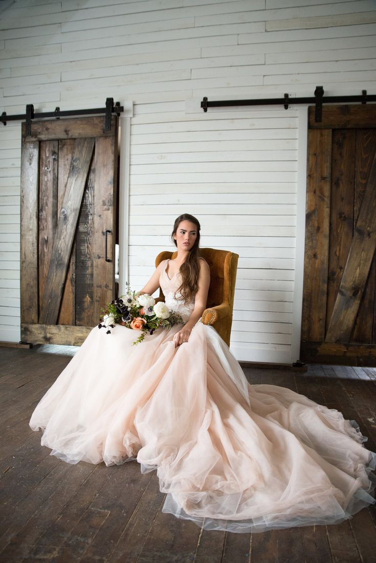 One of the greatest things about a styled shoot or real wedding is seeing  our gowns come to life in a different way on every bride. This rustic  wedding inspiration shot by Erin Elizabeth Photois one we just had to  share! See the full editorial on Utterly Engaged.  photography:erin thunell,erin elizabeth photo  floral:rachael affleck, rachael ellen events  table styling and film:brenna williams,film and flowers  cake:cassidy budge, flour & flourish  calligraphy: karli lapoint…