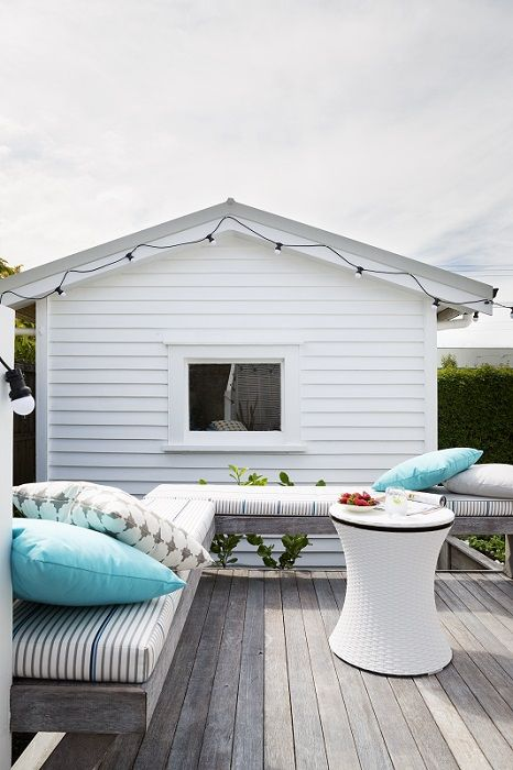 The final reveal! A light, fresh Scandinavian look was achieved by using Cabot's Deck & Exterior stain in Silver Beech colour on the decking timber. We added a fresh mix of custom made cushions and squabs in UV resistant fabrics designed to go outside. Decorating products are available in New Zealand through Guthrie Bowron stores.
