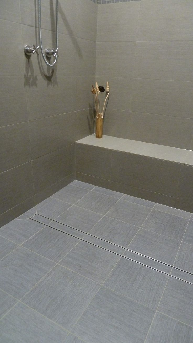 Photo contest finalist. Simple and stunning shower design featuring LUXE Tile Insert Linear Drain.