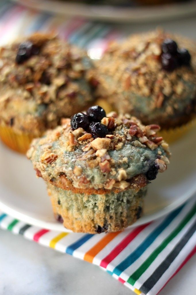 Greek Yogurt Blueberry Crumble Muffins - Moist, fluffy blueberry muffins with crunchy pecan lids! Made with healthy protein packed Greek yogurt.