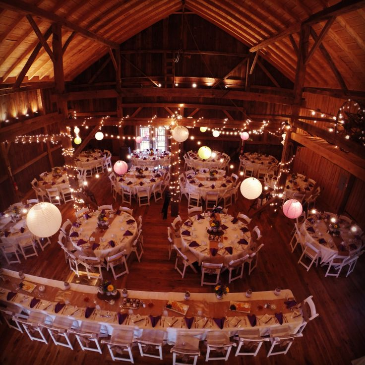 Rustic barn wedding set up with lights