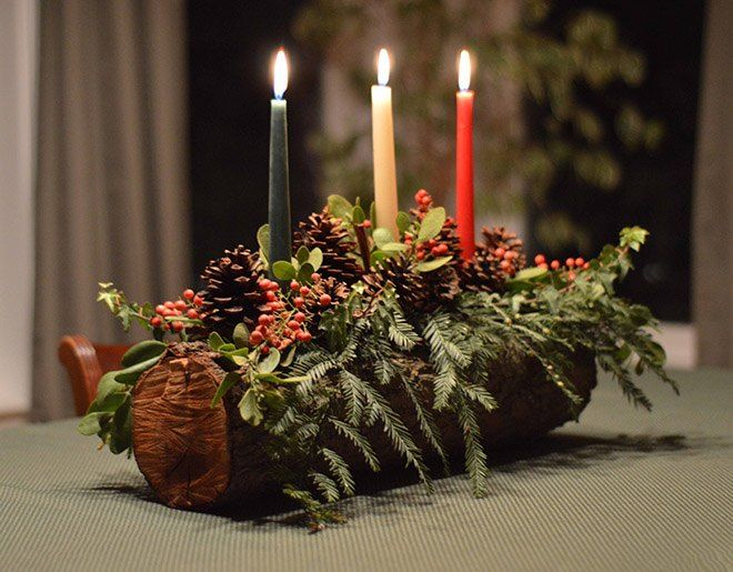 Christmas Yule Log DIY Tutorial; drill hole for candles, hot glue the greenery and add decoration.