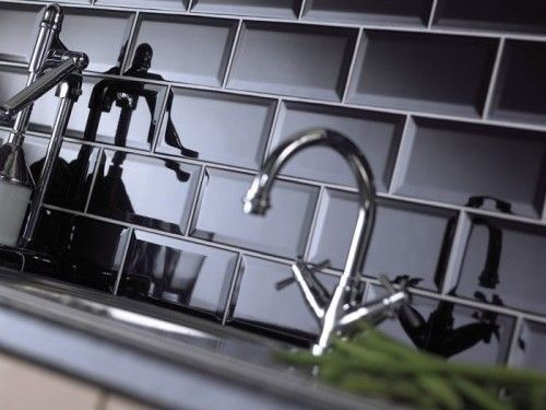 Black Subway Tile Kitchen Backsplash - with white cabinets and black granite counters... possibly