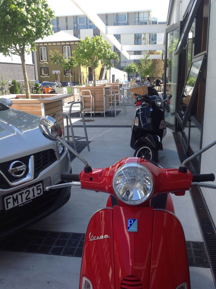 Vespa's At prefab one red two black and of course my Orange Baby