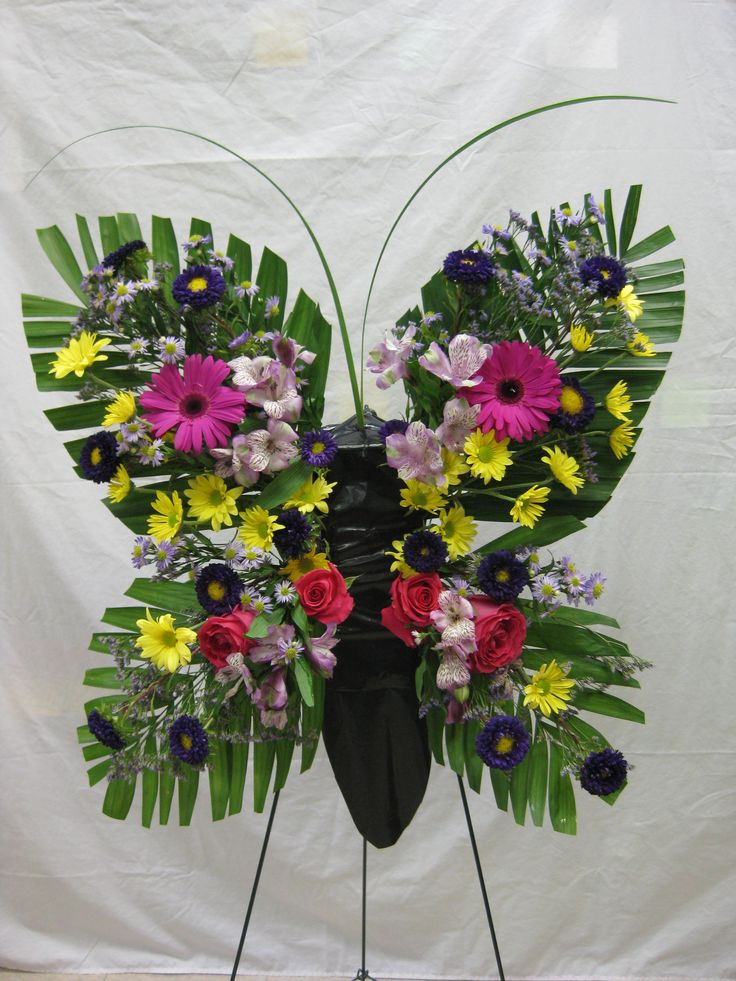 Funeral flower stand. #funeralflowers #butterfly