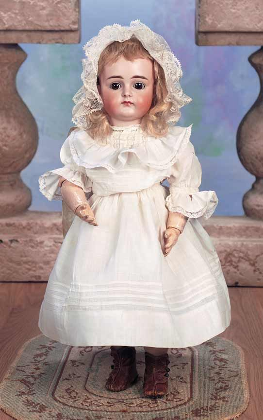 """Beautiful German Bisque Child,XI,by Kestner 17"""" (43 cm.) Marks: XI. Comments: Kestner,circa 1885. Value Points: superb virtually unplayed with condition of the beloved closed mouth child,gentle expression enhanced by fine luminous patina of bisque."""
