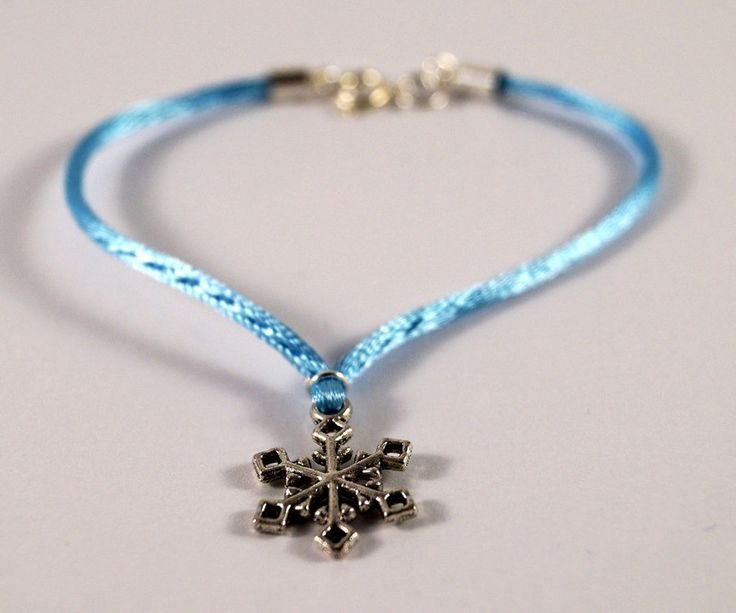 Light blue bracelet with snowflake charm by TosTosia