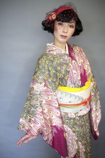 Model wearing a kimono with a peacock pattern. Japan