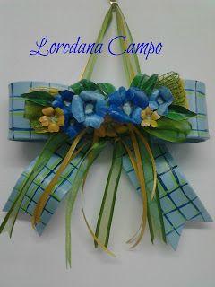Il Bosco Incantato: Fiocco nascita in terracotta dipinto a mano con applicane fiori in lamina