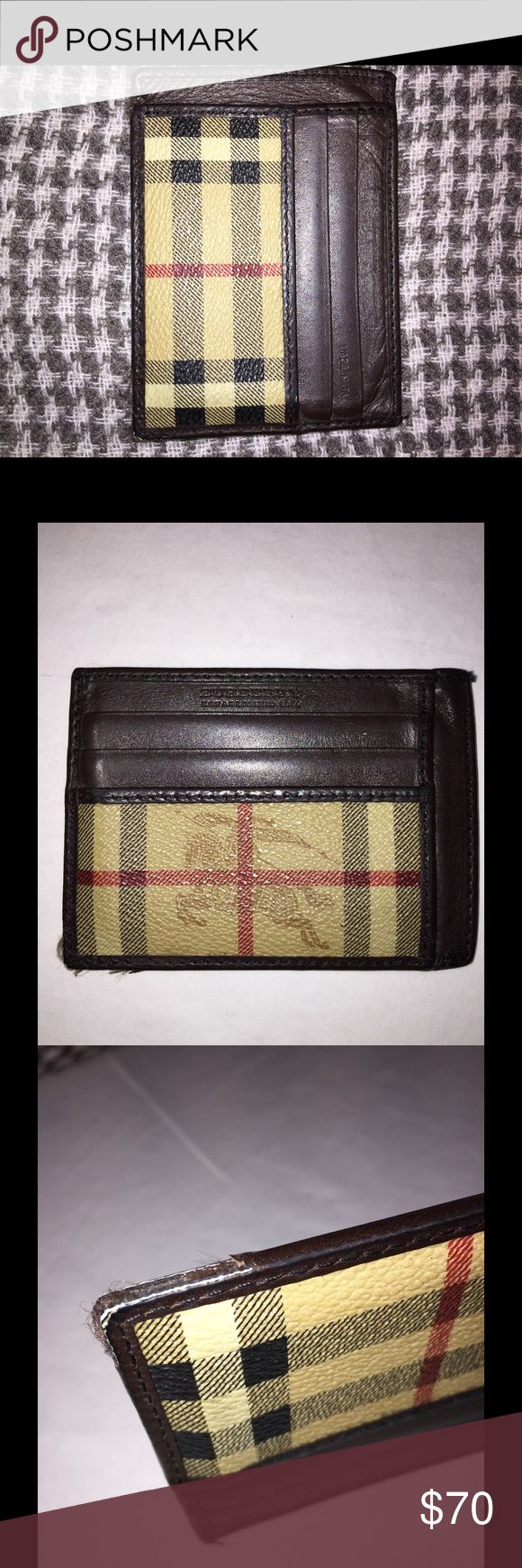 Burberry Men's Wallet Card Holder Super thin. Credit card case holder. Good condition. Opening in center for cash. Has some wear on one of the corners as shown in pics. Burberry Accessories