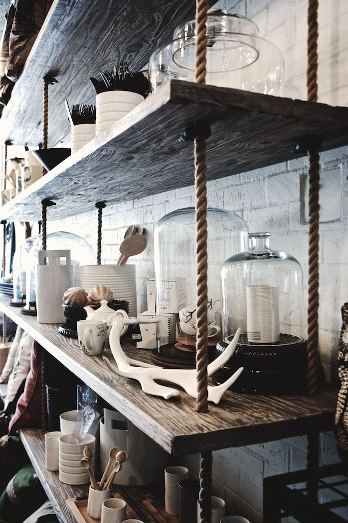Brilliant shop interior via Studio Number 19: Reclaimed wood shelves hang from rope.