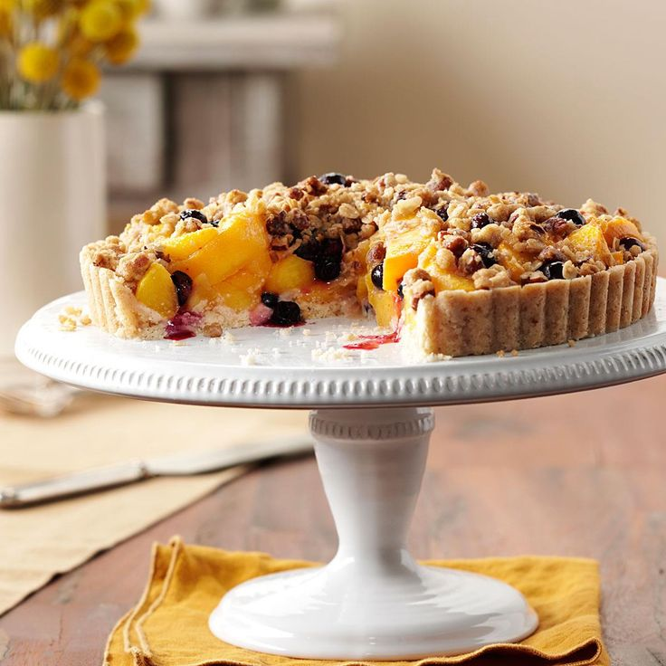 Peach-Blueberry Crumble Tart Recipe -This easy-to-prepare tart is a family favorite, fresh out of the oven or at room temperature with a scoop of vanilla ice cream. —James Schend, Pleasant Prairie, Wisconsin