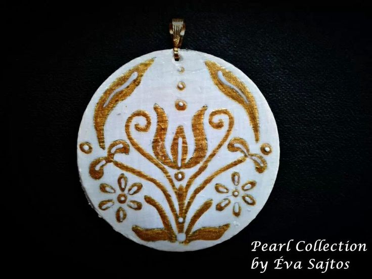 White and gold handmade painted medal