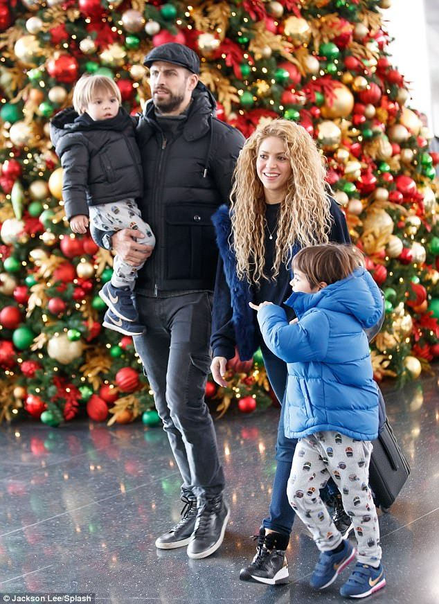 Merry! Two-time Grammy winner Shakira and her athletic partner Gerard Piqué landed at New York's festively-decorated JFK Airport on Christmas Eve with their two adorable boys in tow