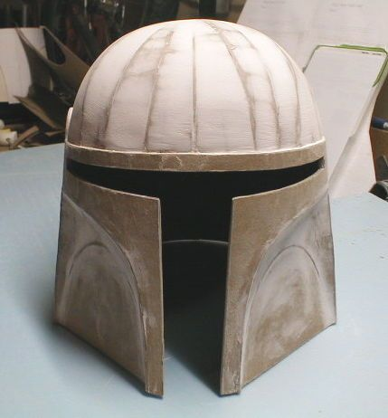 Making cardboard helmets (plus some downloadable templates if you want to make Fett's helmet here) :D Cardboard and spackle, yay!