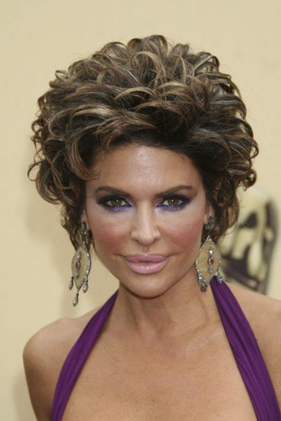 WORST: From the teased updo to the purple eyeshadow, Lisa Rinna looked like she belonged in a Las Vegas show at the Oscars in 2009.