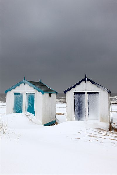 winter snow on the Beach Huts at Southwold, Suffolk, England, UK   Gary Homer, East Coast Images UK