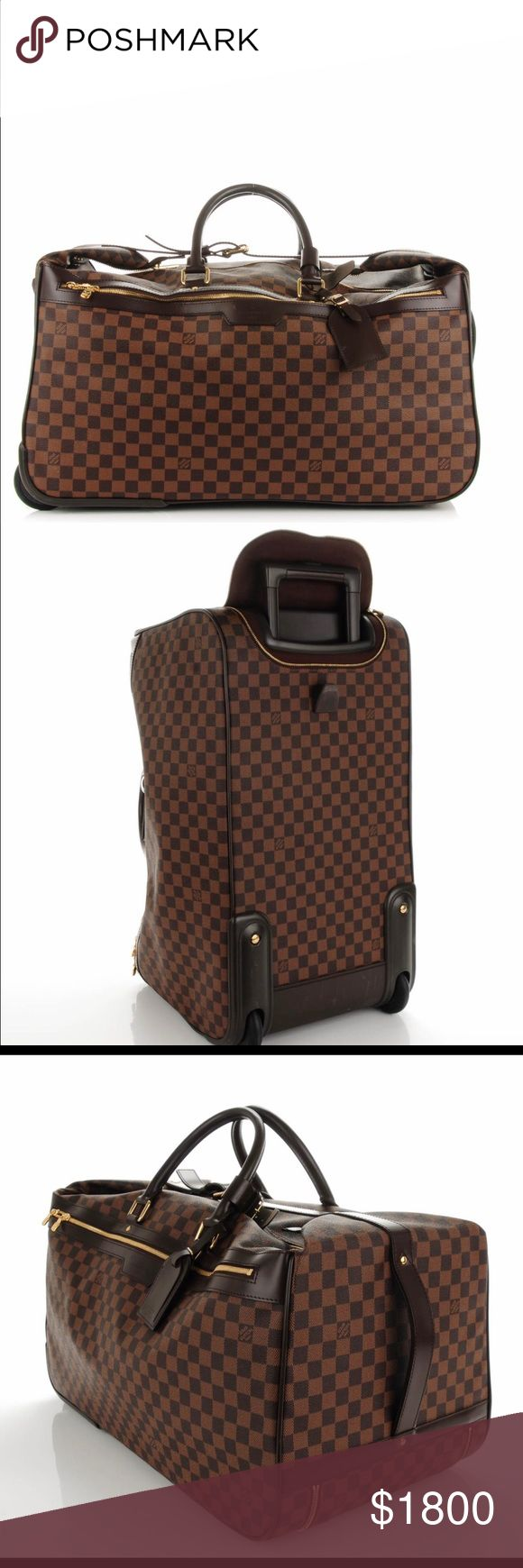 "LOUIS VUITTON Damier Ebene Eole 60 authentic LOUIS VUITTON Damier Ebene 60 signature damier classic check toile canvas. The bag features rolled top mocha leather handles with polished gold links, leather trim for structure, top of the line internal retractable handle mechanism, frame with rear wheel and two opposite flaps that close together with a belt and buckle.    Length: 23"", Height: 12"", Depth: 12"", Drop: 6"" Louis Vuitton Bags Travel Bags"