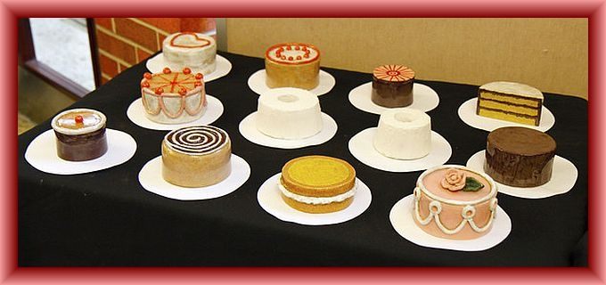 Twelve Ceramic Cake Sculptures....they look real enough to eat!