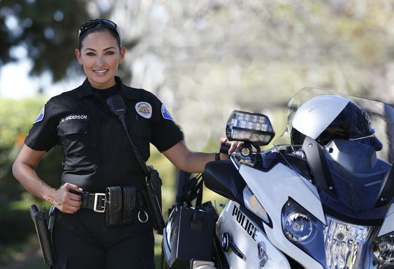 Garden Grove Police Department's Katherine Anderson, one of only five female motor officers in Orange County, is on her third tour of duty with the motorcycle unit. Photo by Christine CotterBehind the Badge - She's back for a third time on Garden Grove PD's motor team, and her heart is revving