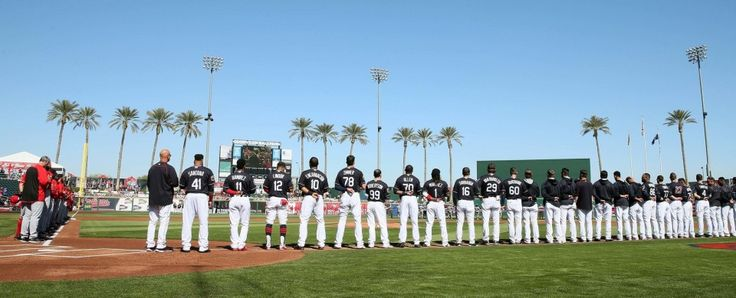 The Cleveland Indians and the Cincinnati Reds during the National Anthem, at the opening ceremonies before the game at Goodyear Ballpark in Goodyear, Arizona on Feb. 25, 2017.  (Chuck Crow/The Plain Dealer) You gotta love baseball.