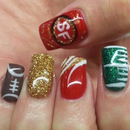 Instagram: @boop711 49ers shellac nails. Red green brown. Gold glitter, yard line, football.