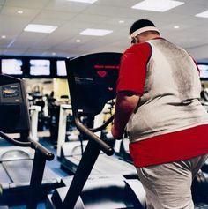 Man walking on treadmill at fitness gym