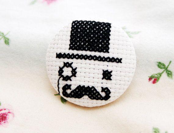 Cross stitched gentleman pin. $15,00, via Etsy.