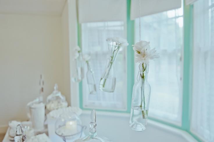 Hanging floral arrangement with aqua coloring