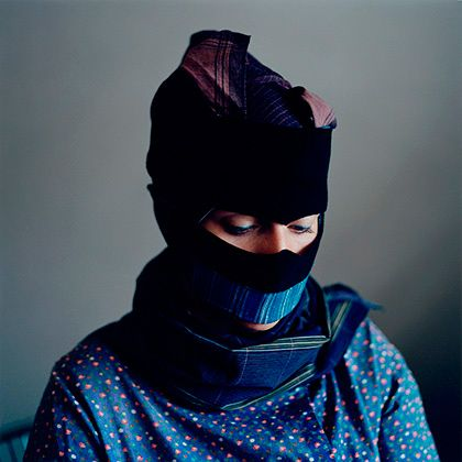 Strude, portrait series by Danish photographer Trine Søndergaard The strude is a scarf that was traditionally worn by the women of the small Danish island Fanø to protect their faces from the harsh elements of Northern Europe.