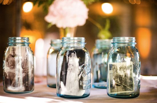 Place wedding photos of family and friends inside Mason jars for a vintage-inspired table topper.    Photo courtesy Jessamyn Harris Photography.