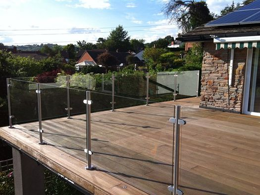 Our Elegance Glass Balustrades offer stylish glass frames with cylindrical posts in a satin or mirror finish. Ideal for balconies, gardens & patio decking!