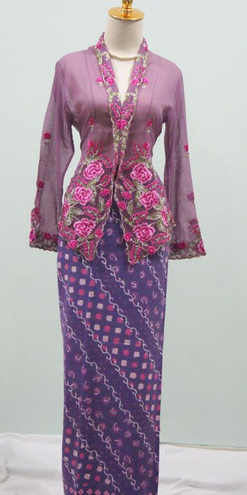 in purple embroidered kebaya