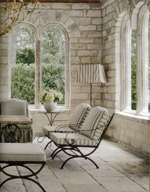 gorgeous stone and brick room with arched windows