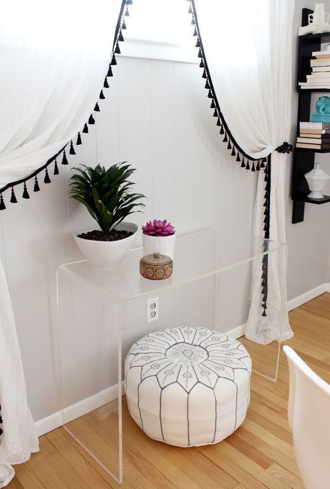 Vintage acrylic lucite console table, white pouf. Tassel fringe from Joann fabrics added to Ikea Matilda curtains.