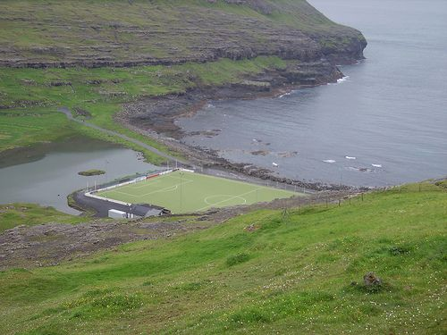 Eidi Stadium, Faroe Islands- As you can see, the complete Eidi Stadium is surrounded by sea! What will happen if the ball goes to the sea? Well, they have a guy in the boat roaming the sea to pick up the balls!  Sportskeeda.com