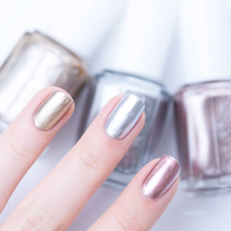 When you can't choose just one, choose them all! Love these mirror metallic essie shades for a trendy chrome nail look. From left to right: a gold metallic 'good as gold' - a memorable silver metallic 'no place like chrome' and an authentic copper metallic 'penny talk'. Shop these metallics: http://www.essie.com/