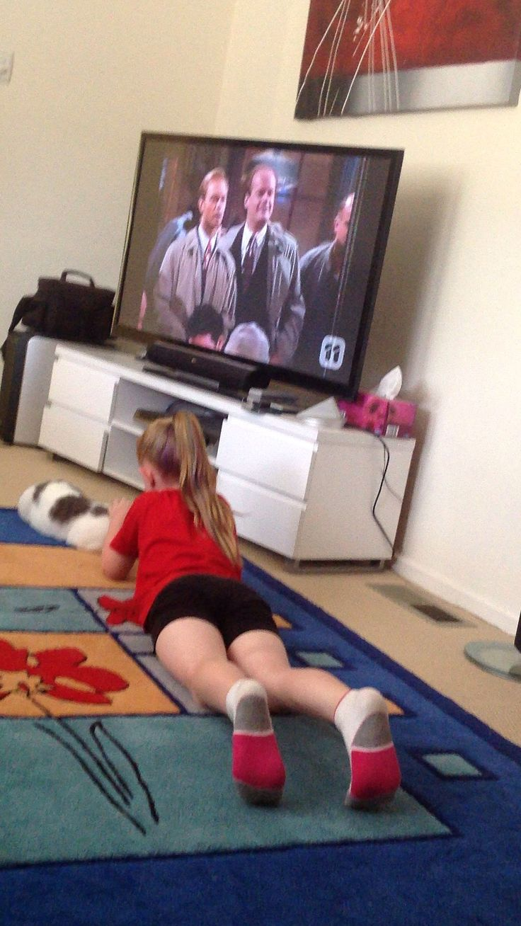 Jaime likes to CHILLAX before Cheer training, with her fluffy friend in front on the TV!!