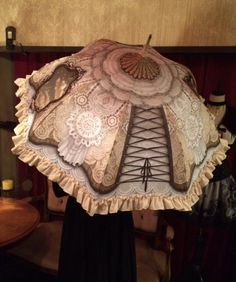 Adore the ruffles, lace, and corset lacing on this parasol. Wonder if there would be a way to do something like this that is 3D and waterproof without making a huge mess when going indoors.