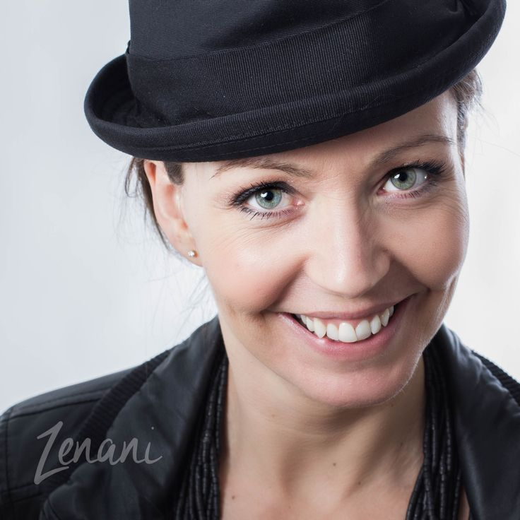 woman with hat, powerful business woman, strong energy, big smile, portrait of business woman, studio photography