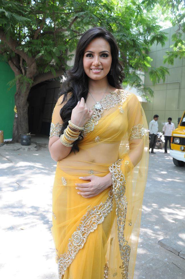Sana Khan in pretty pale yellow #Saree