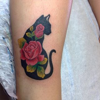 This cat who is feeling particularly rosey. | 26 Totally Purrr-Fect Cat Tattoos